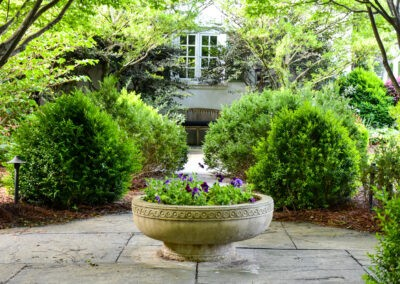 garden tour boxwoods and pansy planter